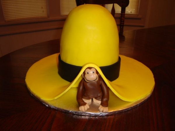 I don't know who could make this cake but i saw it and thought it would be perfect for Asher because for the longest time he called the show either just Yellow Hat or Man in the Yellow Hat. Adorable!
