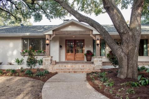 Chip and Joanna Gaines transformed an ordinary looking ranch house into this smartly updated home with Craftsman inspired exterior and a decidedly French country flavor inside.