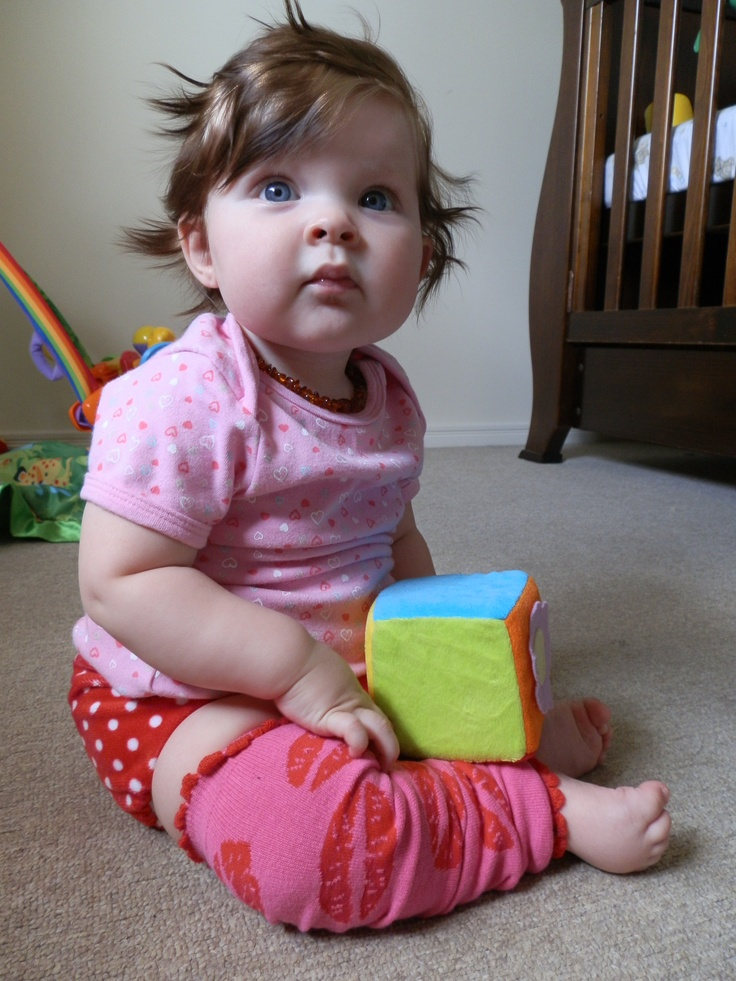 Lily (6 months) wearing her large sio Strawberry fields d'lish