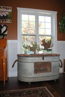 Now how clever is this? Turn an old watering trough into a vintage/industrial console. Keep the top removable so you can use it for hidden storage: