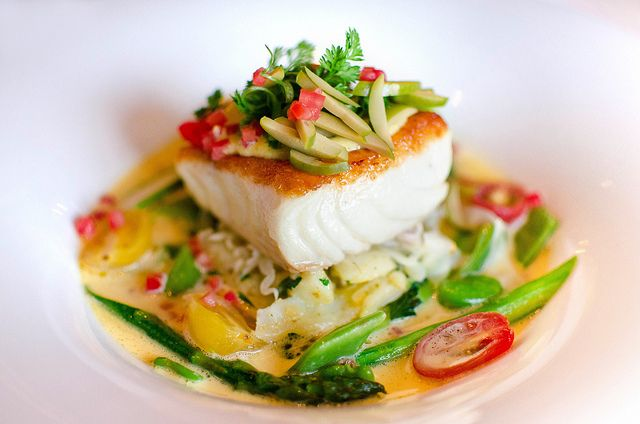 Pacific Halibut with olive oil crushed fingerling potatoes, broad beans, asparagus, fennel, fava beans, cherry tomatoes, citrus saffron nage, Cerignola olive aioli