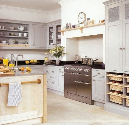 The stainless steel Mercury range combined with the light wood and white colour scheme of this kitchen helps contribute to the refreshing, modern Scandinavian styling.