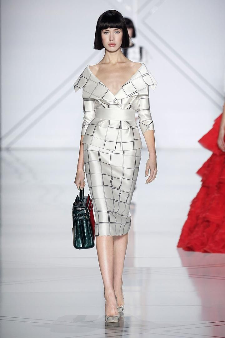 Monochrome graphic chequered silk zibeline tailleur with off-the-shoulder revere collar and wide belt.