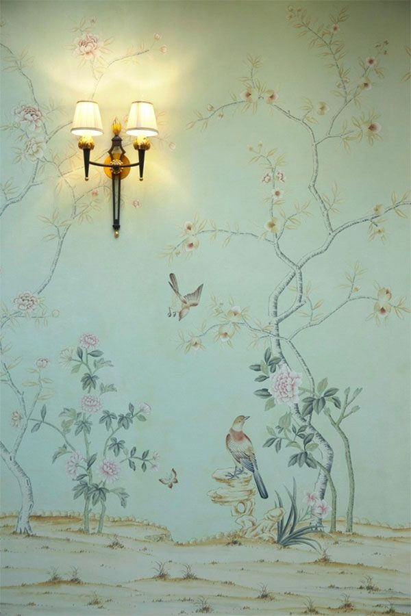 chinoiserie wallpaper and sconces. Delicate and delightful