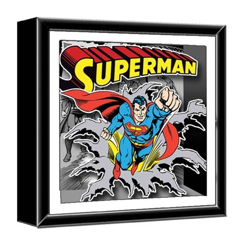 Spruce up your home with this geeky Superman Wood Shadow Box and turn it into a fortress of solitude. Show your love of Superman in 3D.  This comic art has a 3-D layout of 4 classic Superman DC comic covers, with Superman flying out of the frame on the Superman #1 background. It measures 14-in