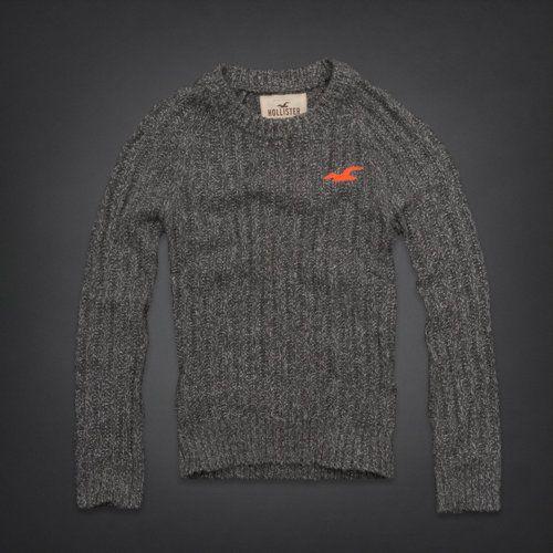 Es un suéter gris.