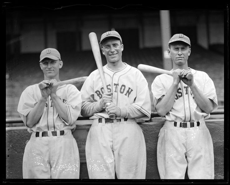 (l to r): Boston Bees Gene Moore, Wally Berger, and Hal Lee shouldering bats in front of the grandstand wall at Braves Field.
