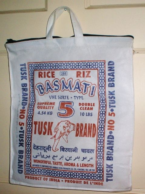 Not a lot of effort required for this creative repurposing! A few tweaks and this bag that I bought rice in serves perfectly as a tote bag for books or lunch