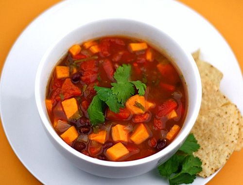 Black Bean and Sweet Potato Soup  ingredients:  1 T olive oil  1 red onion, chopped  3 cloves garlic, minced  1 large sweet potato, peeled and chopped  1 roasted red pepper, chopped (you can use jarred)  2 cans low sodium vegetable broth (15 oz. size)  2 cups water  3 cans low sodium black beans, rinsed and drained  3 cans diced tomatoes with green chiles  1 T chili powder  2 teaspoons cumin  Dash of red pepper flakes  1/2 bunch of cilantro, chopped  Salt and pepper, to taste    directions:  ...Sweet Potato Soup, Black Beans Soup, Food Blog, Vegetarian Soup, Potatoes Soup Recipe, Food Soup, Mr. Beans, Sweets Potatoes Soup, Soup Recipes