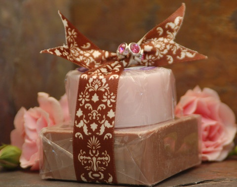 A satin ribbon and a dash of bling wrap their arms around Roses' and Chocolate! This gift offers one 3.5 oz bar of our amazing Cocoa Mint olive oil soap and one 2 oz bar of our delicate Zirkel Rose olive oil soap. The twinkle of love is in the air!