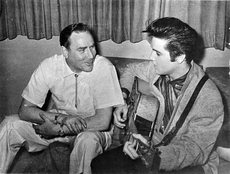 Elvis Presley is pictured with deejay Dewey Phillips in Charles and Bonnie Underwood's apartment at Holiday Towers in Memphis, TN on Monday evening, April 15, 1957. See more here: http://brian56.dk/50s/1957/5704/570415.html