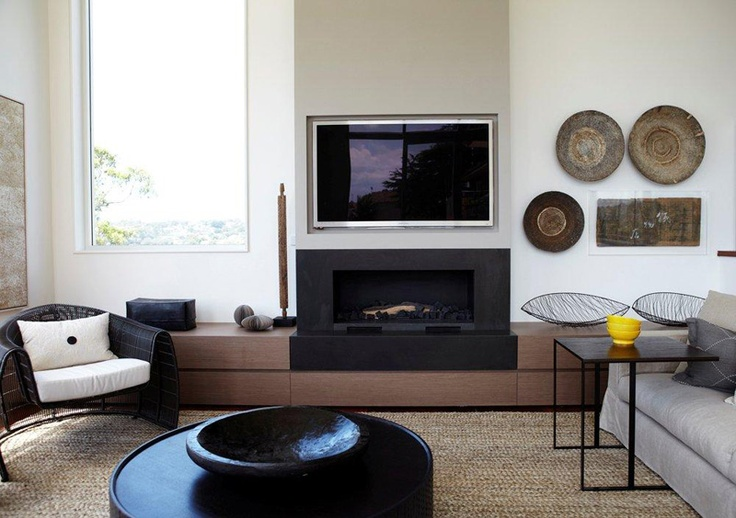 Low level cabinetry w/ fireplace and TV