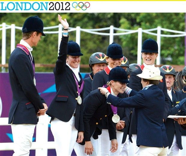 GB Equestrian Team, mum presents daughter with silver medal.