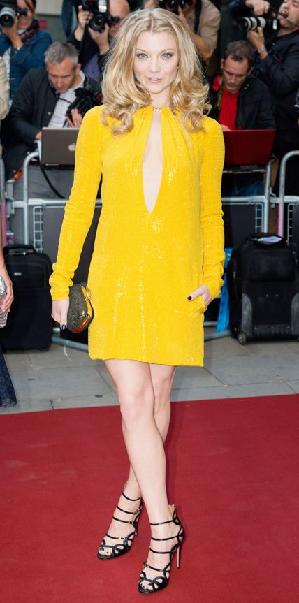 Natalie Dormer lit up the red carpet at the 2014 GQ Men of the Year Awards in a plunging yellow long-sleeve Emilio Pucci dress embellished all over with crystals. Wavy bombshell tresses and black strappy sandals completed her look.