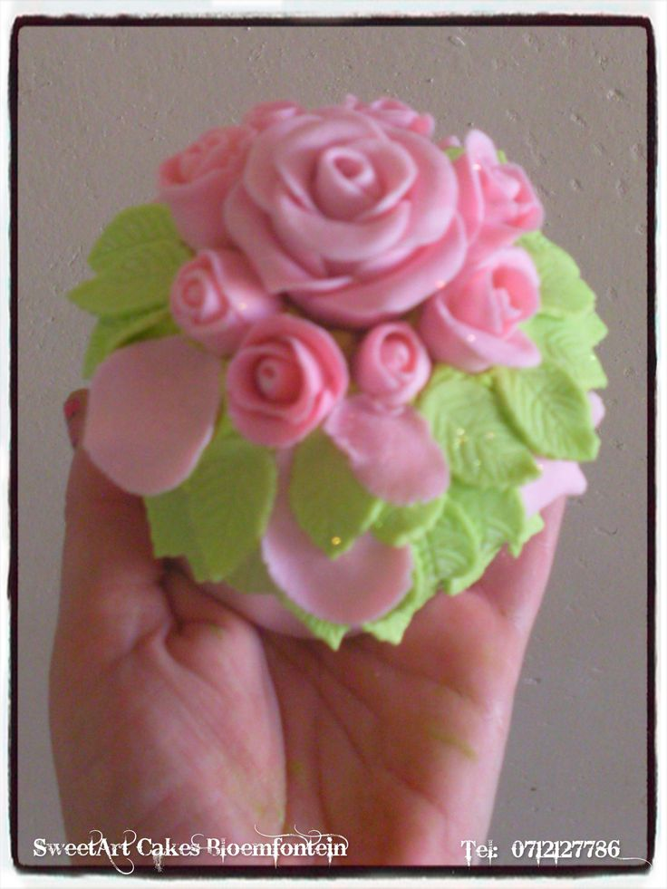 Bunch of fondant roses cupcake (Decor available for sale separately) For more info or orders, email SweetArtBfn@gmail.com or call 0712127786.
