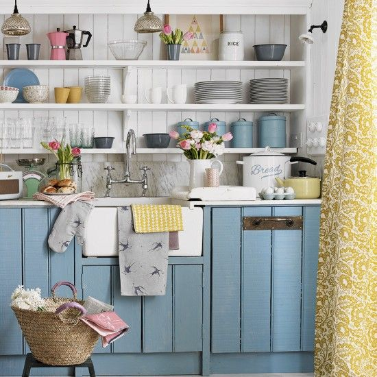 Country kitchen with blue painted cabinets and open shelving and a lovely Cloth & Clover Himbleton ochre curtain.. www.clothandclover.com