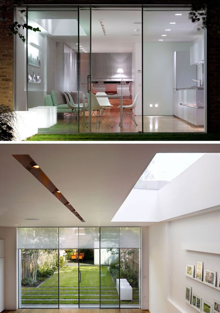 Connecting the updated interior of this house to the backyard is a set of slim framed sliding doors that have been designed to have the frame buried to allow for an uninterrupted view of the garden.