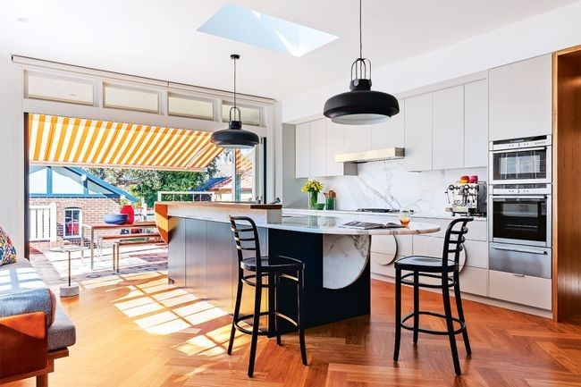 18 unique kitchen ideas to inspire your next renovation: An oval island bench in this kitchen by Arent & Pyke creates a beautifully free-flowing space perfect for a busy Sydney family.