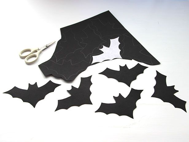 bat cut out on construction paper halloween window decorationsfront - Halloween Cutout Decorations