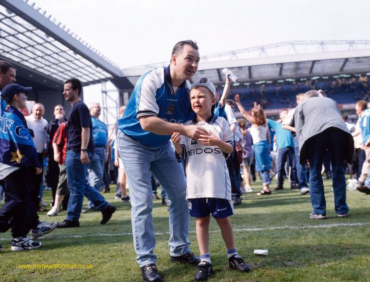 Boy looks to leave the stage, Manchester City at Blackburn Rovers,England 2000. Stuart Roy Clarke.