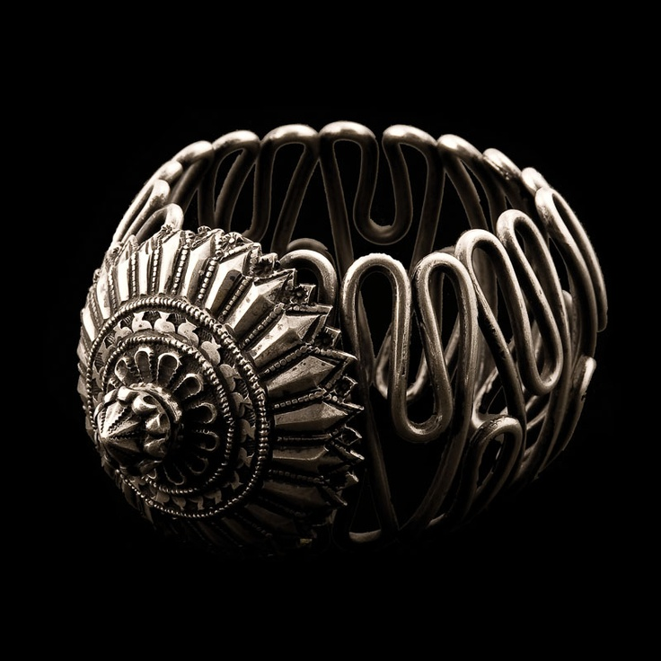Very occasionally, you'll come across an antique treasure which plays on tradition to reveal individual flair, like this piece. Its Indian designer set the traditional domed centrepiece atop a voluptuously twisting coil of silver. This inventive design allows the bracelet to be stretched/compacted, depending whether you wear it on wrist or arm. This dazzling bracelet is perfect for one particular individual.  Silver Bracelet/Armlet  India  Circa 1920s  Wrist Dia 6cm  Pair Available  242g…