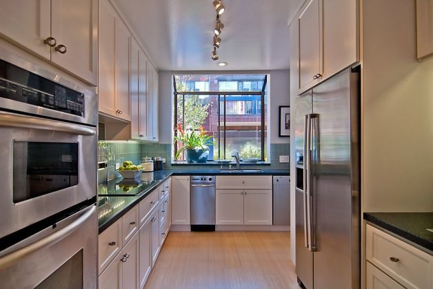 Light bamboo floors and stainless steel lightens up small area. Photo: Sean Poreda / SF
