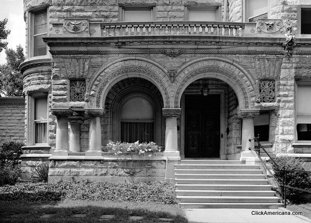 Old Louisville: The lavish Conrad-Caldwell House. Must be an old image. The flower urn is not there. And the lilacs aren't either