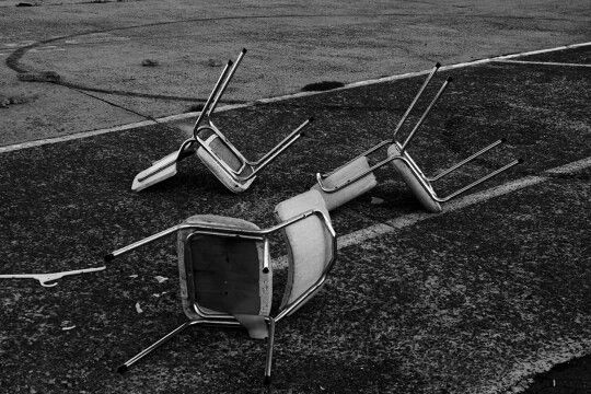 Black and white photography industrial rubbish pollution chairs abstract