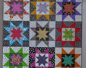 This quilt is based on the popular Bouillabaisse pattern, hence from where the title of my quilt comes. Using so many brightly colored fabrics makes