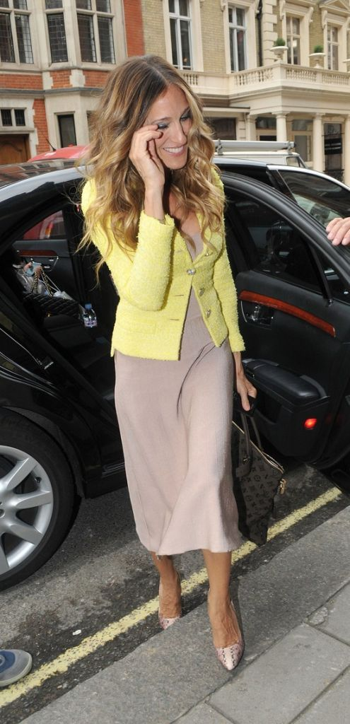 neon cardigan over a neutral midi dress as seen on Sarah Jessica Parker