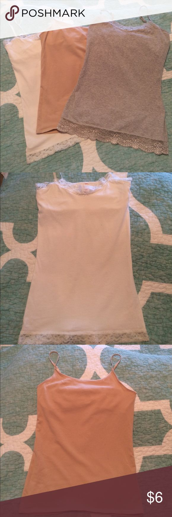3 fitted cami's with shelf bra 3 Medium fitted cami's with shelf bra and adjustable straps. White and gray have lace detail on top and bottom, beige does not. Tops Camisoles