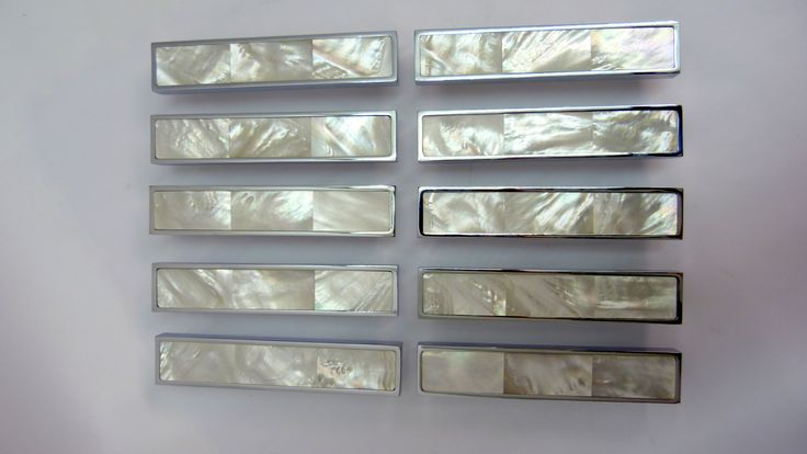 Mother of Pearl cabinet handles in chrome finish. By Phillips & Wood