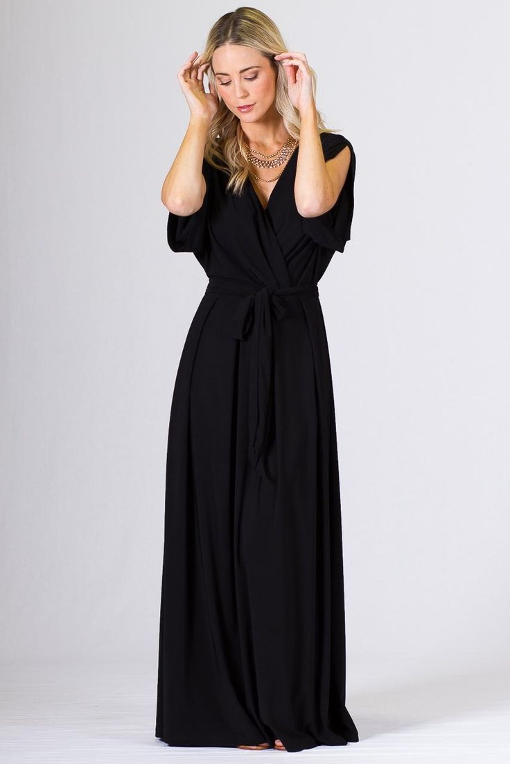 """Batwing Long Maxi Dress - Black - Paper Scissors Frock. Long Batwing style maxi with deep cross-over look front, box pleating, gathering on the sleeves & batwing style sleeve. Comes with a removable belt in the same fabric as the frock.  Made from high quality ITY polyester.  Pictured Models is 5'8"""""""