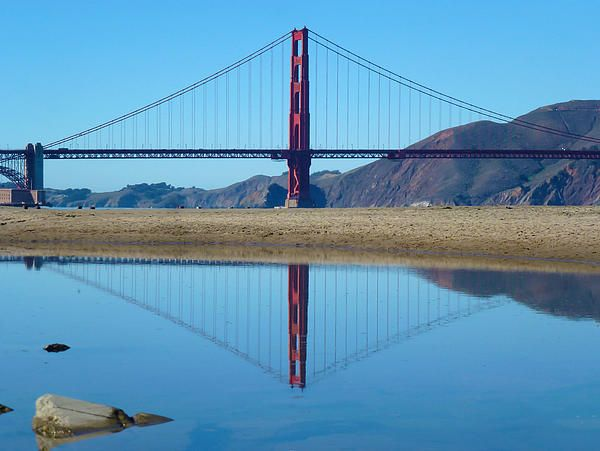 A mirrored effect of the Golden Gate bridge using glass like water. Taken November 2014 about an hour walk from San Francisco city. Want this picture printed on canvas or cards etc? Click on the image :)