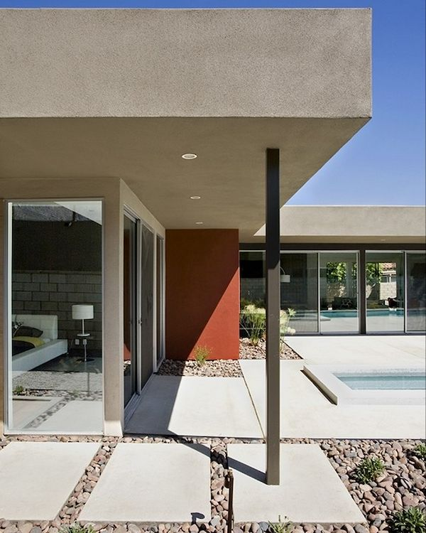 Concrete, gravel + tons of #windows create a picturesque #midcentury #modern exterior