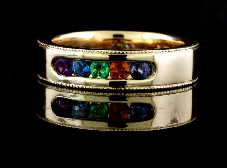 Custom designed and hand crafted, Men's 14k yellow family ring.Features channel set amethyst, blue zircon, emerald, citrine and sapphire gemstones.