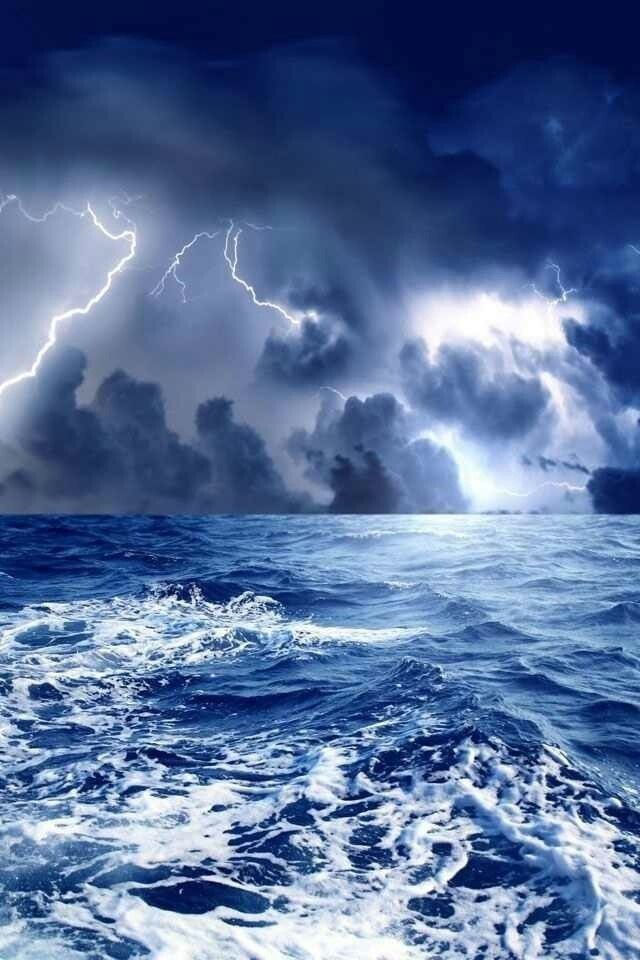 Spray/froth from the Boat across the deep Blue water at night, when taken at the precise time of Lightning from the Storm ,gives a simplistic yet brilliant two-toned Blue-and-White effect in Picture..