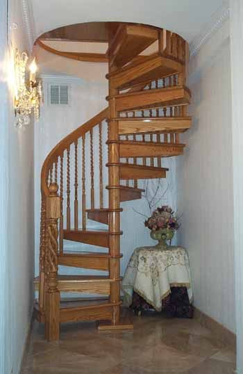 Oak Spiral Stairs with Carved Newell Posts
