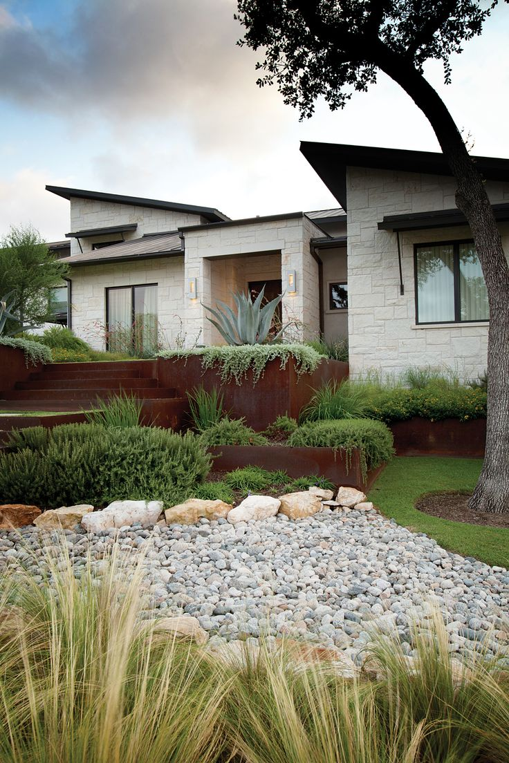 Corten steel retaining walls and stair risers.  Adds great color and contrast of material.  (design by LandWest Design Group)