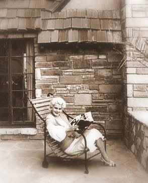 Jean Harlow relaxing at the home Paul Bern built for her in Benedict Canyon.