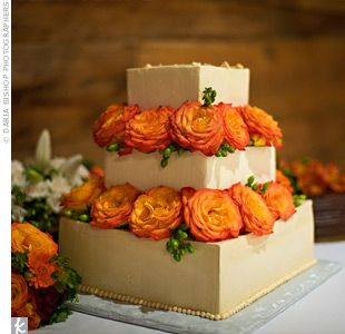 Brilliant orange circus roses and hypericum berries separated each tier of the wedding cake. It not only looked like autumn, but tasted like it too, with layers of spice cake, maple-caramelized apples, and maple buttercream.