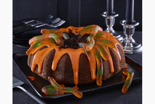 """Dress up a fall-flavoured bundt cake with orange icing, Oreo or chocolate """"dirt"""" and gummy worms for a memorable Halloween dessert."""