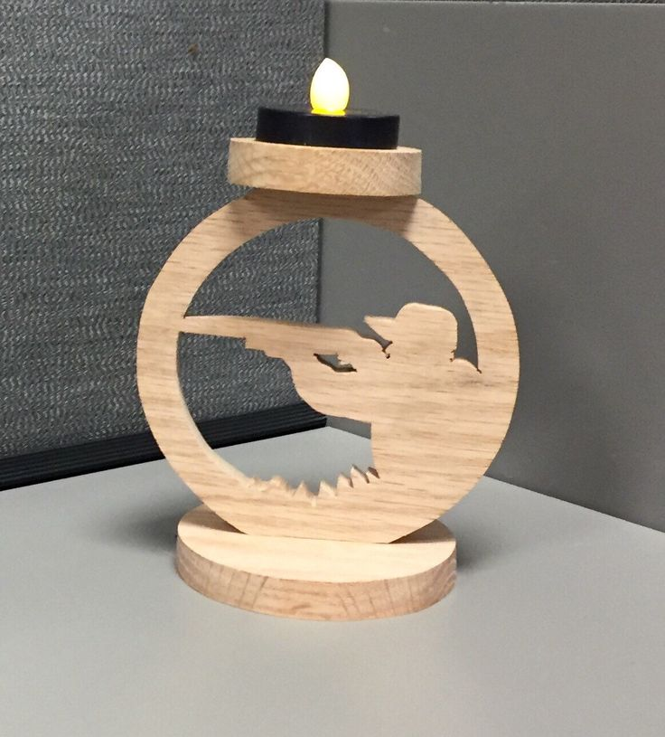 A personal favorite from my Etsy shop https://www.etsy.com/listing/247560552/handcrafted-wooden-deer-hunter-tea-light