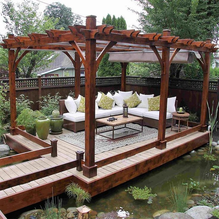 Let's take a look at this amazing and fascinating pergola. It is a fairy land and dreamland kind of pergola, all decked up on a pond in your garden. It is really important to choose a landscape to build a pergola and nothing is better than building it on a nice pond or mini-lake. The sitting arrnagement should be relaxing and comfortable surrounded by green and leafy plants.