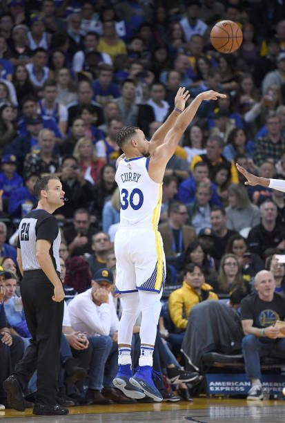 Stephen Curry of the Golden State Warriors shoots against the Philadelphia 76ers during an NBA basketball game at ORACLE Arena on November 11 2017 in...