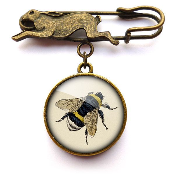 A gorgeous brooch featuring a brass hare and an image of a bee taken from a Victorian scrap. This design is part of the 'Eclectic Range'.The image has been printed with archival pigment ink and sealed for longevity, then encased behind a glass cab...