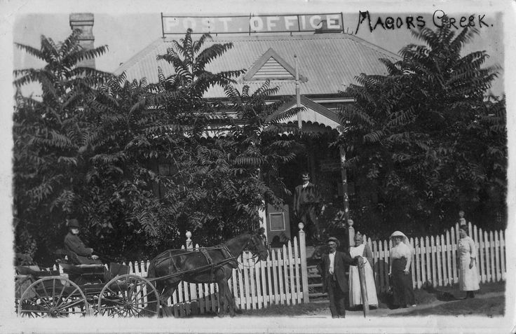 image299 Post Office Majors Creek. Mail arriving, P.M. JW (Billy Wiggins on verandah, Granny Wiggins in apron, Mrs Grant in white frock and Sarah Stinson in black skirt and white blouse.