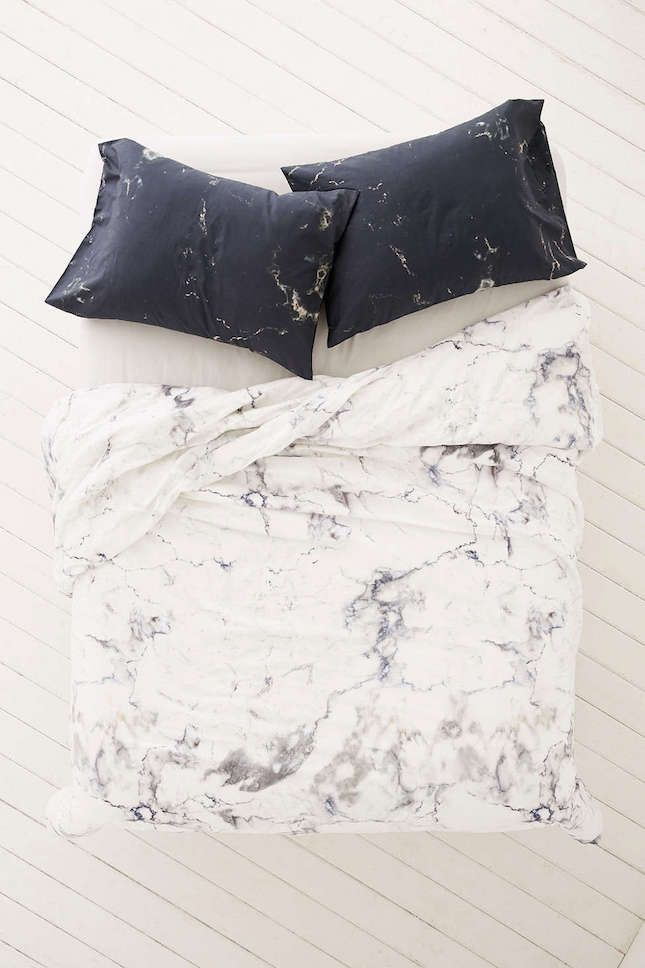 Bring a print element into your bedroom with this marbled black + white duvet cover.