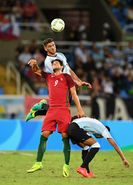 Lisandro Magallan of Argentina heads the ball during the Men's Group D first round match between Portugal and Argentina during the Rio 2016 Olympic Games at the Olympic Stadium on August 4, 2016 in Rio de Janeiro, Brazil.