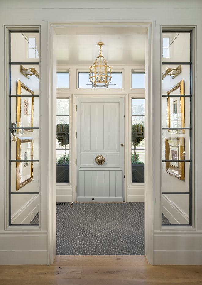 Foyer Flooring. Foyer with slate floor tile set in herringbone pattern. Foyer opens to living room with wide plank white oak floors.